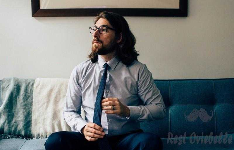 Portrait of young man on sofa how fast does hair grow men